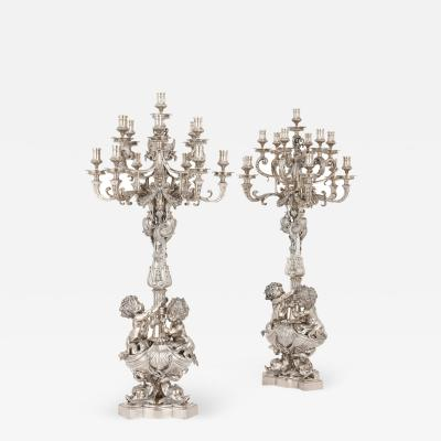 Two large Louis XIV style silvered bronze thirteen light candelabra