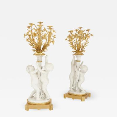 Two monumental biscuit porcelain and gilt bronze candelabra