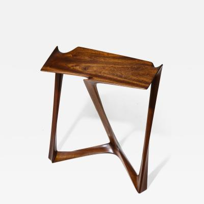 Uniquely designed side table Executed in Sapele Traite wood