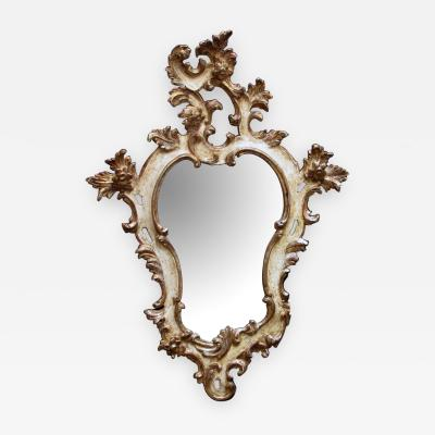 Venetian rococo revival ivory painted and parcel gilt cartouche shaped mirror