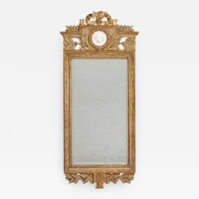 Very fine Gustavian mirror scraped to original guilt 19th Century