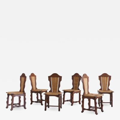 Victor Courtray Set of Six Victor Courtray Attributed Dining Chairs in Oak and Rush 1950s