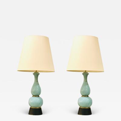 Vintage pair of blue pottery lamps on black plinth vases