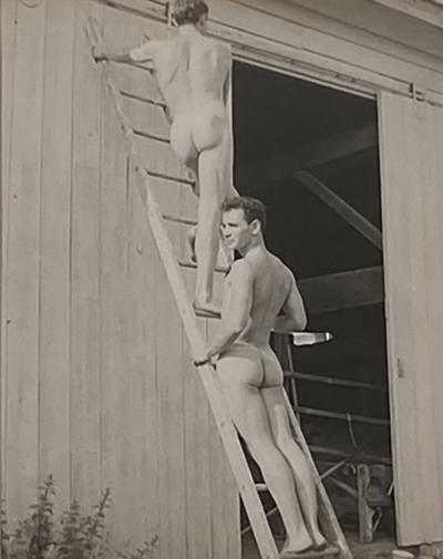 Vintage photograph of two men on a ladder American Circa 1950