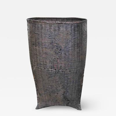 Vintage tribal storage basket of bamboo rattan and wood in karen of burma style