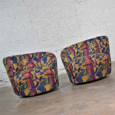Vladimir Kagan Pair of asymmetric nautilus swivel chairs in style of vladimir kagan