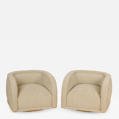 Vladimir Kagan Swivel club chairs circa 1980 Upholstered in an Italian texture fabric