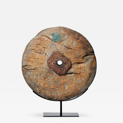WOODEN WHEEL ON METAL STAND