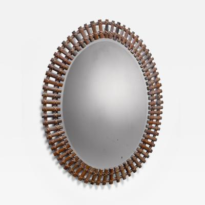 Wall mirror in oval bamboo frame