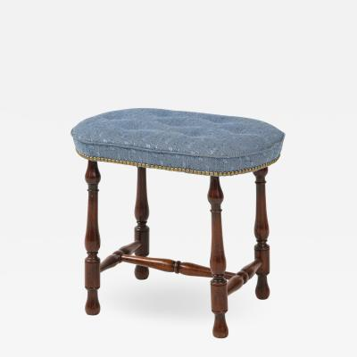 Walnut stool made from and 18th century stool base with new upholstered top
