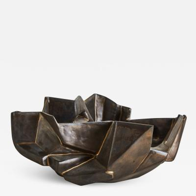 Wheel thrown and manipulated cubist low vessel