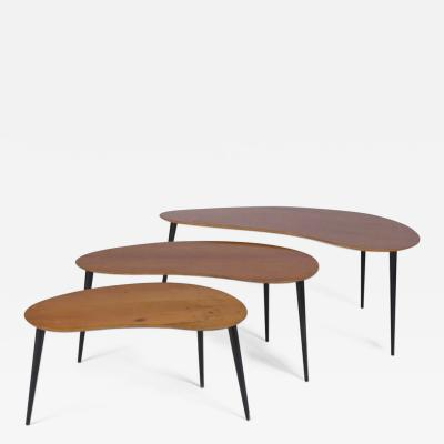 Work from the 1950s 60s Suite of three bean shaped tripod nesting tables