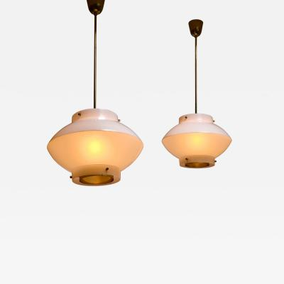 Yki Nummi Pair of Yki Nummi White Plexiglass and Brass Pendants for Orno