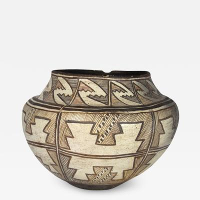 Zuni four color polychrome jar with geometric designs