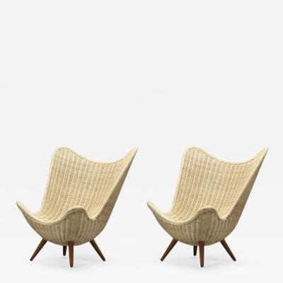knud Vinther Knud Vinther organic pair of lounge chairs in rattan and tapered oak legs