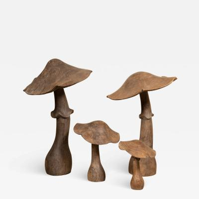 set of four wooden mushrooms early 20th century