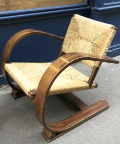 Adrien Audoux Frida Minet Audoux Minet pair of bent wood lounge chair with a rare rush cover - 911733