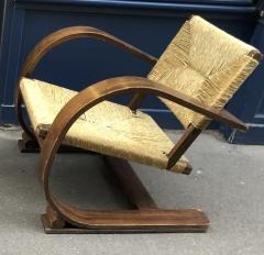 Adrien Audoux Frida Minet Audoux Minet pair of bent wood lounge chair with a rare rush cover - 911744
