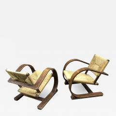 Adrien Audoux Frida Minet Audoux Minet pair of bent wood lounge chair with a rare rush cover - 912736