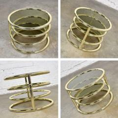 Design Institute America Modern round brass smoke glass end table or coffee table w pivoting tiers - 1681981