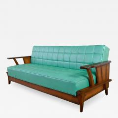 Economy Furniture A brandt ranch oak style turquoise vinyl convertible sofa daybed - 2132042