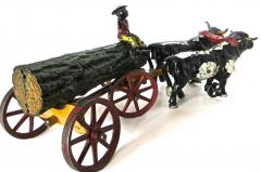 Hubley American Cast Iron Toy Oxen Drawn Log on Carriage with Rider Hubley Ca 1906 - 531602