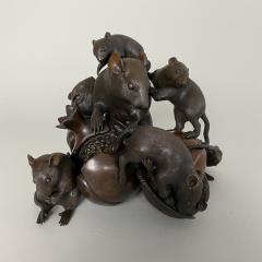 Itsumin An antique Bronze Okimono of a family of rats devouring a pomegranate - 1585341
