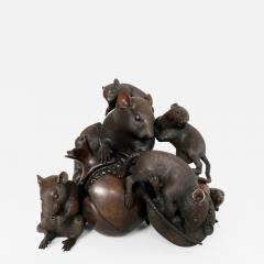 Itsumin An antique Bronze Okimono of a family of rats devouring a pomegranate - 1585729