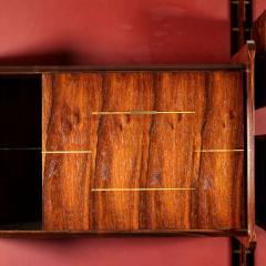 La Permanente Mobili Cant Bookcase La Permanente Mobili Cant Rosewood Brass Leatherette 1950s - 1980541