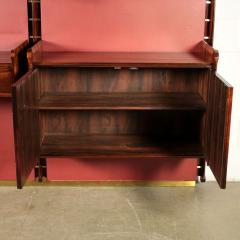 La Permanente Mobili Cant Bookcase La Permanente Mobili Cant Rosewood Brass Leatherette 1950s - 1980550