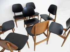 La Permanente Mobili Cant Set of Eight Black Faux Leather and Wood Dining Chairs - 1654081
