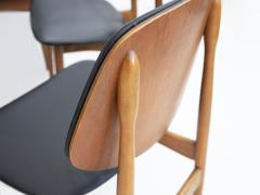 La Permanente Mobili Cant Set of Eight Black Faux Leather and Wood Dining Chairs - 1654082