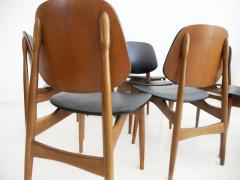 La Permanente Mobili Cant Set of Eight Black Faux Leather and Wood Dining Chairs - 1654088