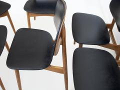 La Permanente Mobili Cant Set of Eight Black Faux Leather and Wood Dining Chairs - 1654089