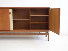 La Permanente Mobili Cant Teak Sideboard with Fabric and Brass Details by Ilmari Tapiovaara - 1565777