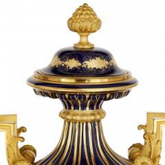 Sevres Manufacture Nationale de S vres Lapis lazuli gilt bronze and porcelain three piece clock set - 1256096