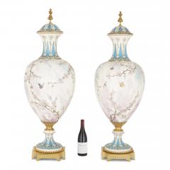 Sevres Manufacture Nationale de S vres Two large gilt bronze mounted Rococo style white porcelain vases - 1274574