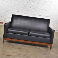 Taylor Chair Co Mid century modern black faux leather love seat sofa by taylor chair co  - 1609384