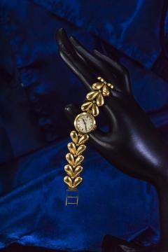 Universal Gen ve 1950s Universal Flower Petal Motif 18 Karat Yellow Gold Bracelet Wristwatch - 1154242