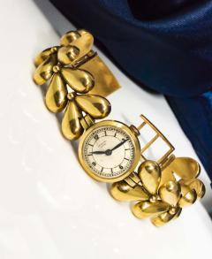 Universal Gen ve 1950s Universal Flower Petal Motif 18 Karat Yellow Gold Bracelet Wristwatch - 1154246