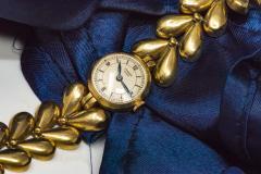 Universal Gen ve 1950s Universal Flower Petal Motif 18 Karat Yellow Gold Bracelet Wristwatch - 1154247