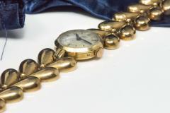 Universal Gen ve 1950s Universal Flower Petal Motif 18 Karat Yellow Gold Bracelet Wristwatch - 1154248