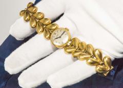 Universal Gen ve 1950s Universal Flower Petal Motif 18 Karat Yellow Gold Bracelet Wristwatch - 1154250