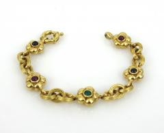 18KT YELLOW GOLD EMERALD RUBY SAPPHIRE FLOWER AND LINK BRACELET - 1089939