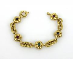 18KT YELLOW GOLD EMERALD RUBY SAPPHIRE FLOWER AND LINK BRACELET - 1089941