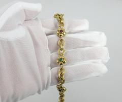 18KT YELLOW GOLD EMERALD RUBY SAPPHIRE FLOWER AND LINK BRACELET - 1089946
