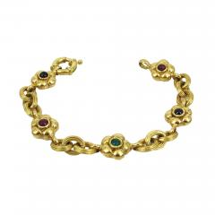 18KT YELLOW GOLD EMERALD RUBY SAPPHIRE FLOWER AND LINK BRACELET - 1090931