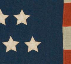 42 Stars in an Hourglass Pattern on an Antique American Flag - 638197