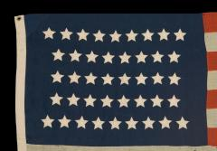 42 Stars in an Hourglass Pattern on an Antique American Flag - 638198