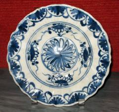 A Blue and White Delft Charger with Floral Splays and Scalloped Edge - 307556